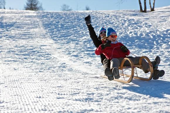 Schlittenfahren im Winter. Foto: © Steinthaler - Kärnten Werbung